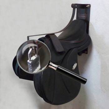 Wall mount saddle holder